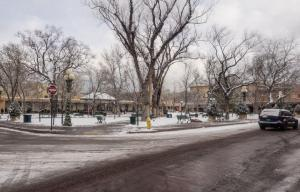 38883210 - santa fe plaza covered in snow during christmas time.